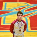 Column: High school wrestlers watch weight all season