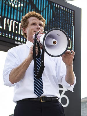 Congressman Joe Kennedy III thanks supporters as they stand out with signs at the intersection of Park Ave. and Pleasant St. on Aug. 5