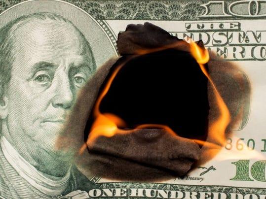 hundred-dollar-bill-on-fire-losing-money-investment-debt-credit-getty_large.jpg