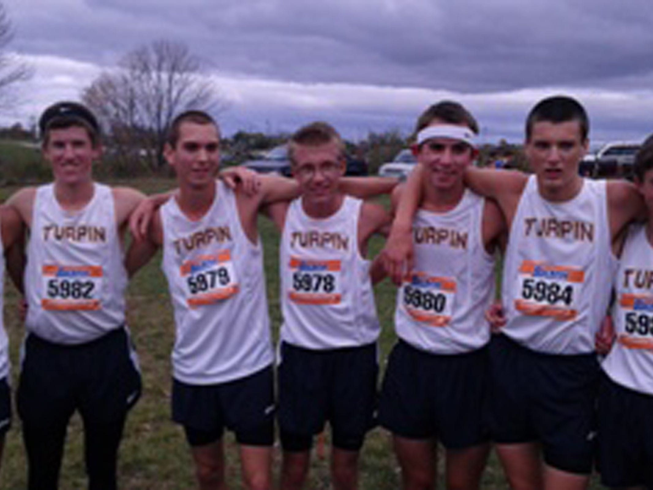 The Turpin boys cross country team placed fourth in the Southwest District meet at VOA Park, qualifying it for regionals. The same core group should lead the Spartans in the track and field season. From left are: Andrew Patty, Alex Tanner, Dante Marcon, Ben Gothard, Ben Norton, Ryan Wiesman and Graham Weaver.