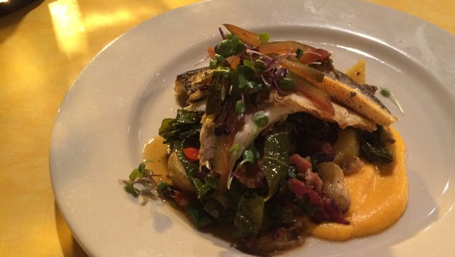 Branzino, the chef's special catch of the day, was pan-seared till crisp then served with roasted potatoes, collard greens and pickled watermelon rind to delicious effect.