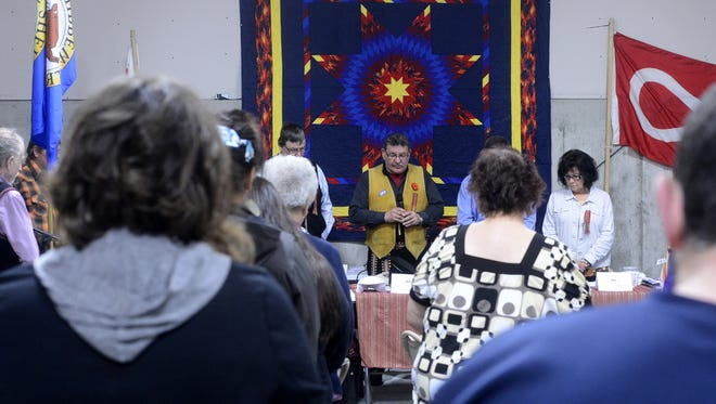 Norman Fleury leads a prayer during the dedication of the Little Shell Chippewa Cultural Center.