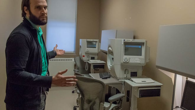 Dr. Brian Dornvos show one of the remodeled eye exam rooms at the Battle Creek VA Medical Center.