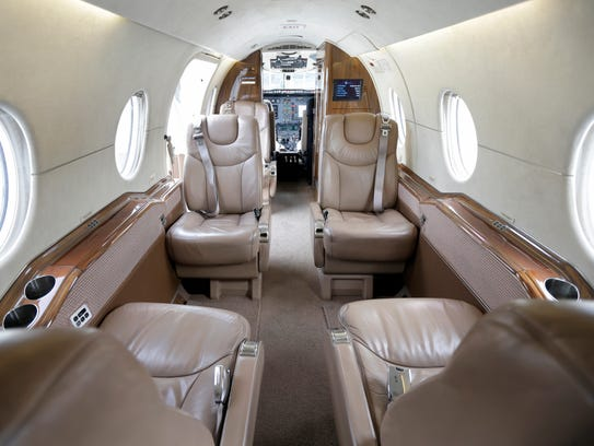 A OneJet airplane seats seven passengers. A media event