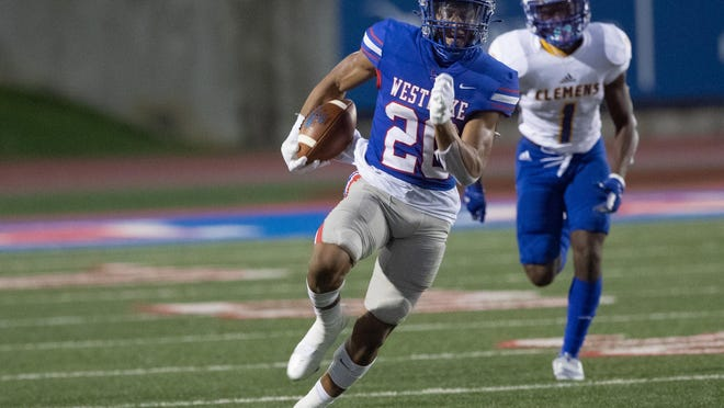 Westlake running back Zane Minors rips off a 76-yard rushing touchdown on the first offensive play during the Chaparrals' 53-7 win over Schertz Clemens at Chaparral Stadium Friday. Minors finished the game with 115 yards and three scores.