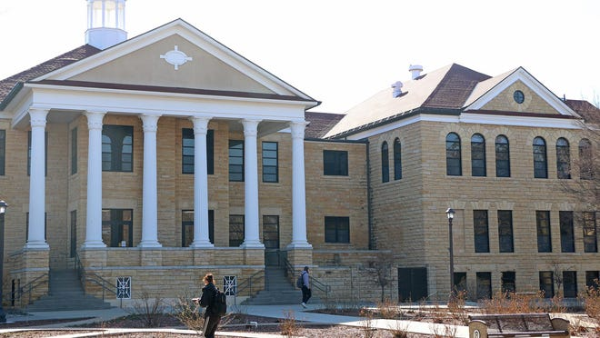 In this March photo, students walk past Picken Hall at Fort Hays State University.