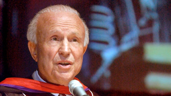 Sun-News photo by Norm Dettlaff Retired New Mexico State University men's basketball coach Lou Henson speaks at the 112th NMSU commencement Saturday at the Pan American Center. Henson was awarded an honorary doctor of laws degree.