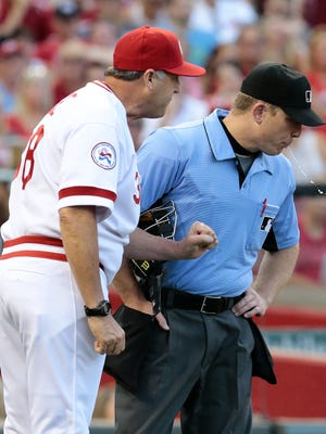 Cincinnati Reds manager Bryan Price (38) argues with umpire Toby Basner (99) over a called strike three in the bottom of the third inning of the MLB National League game between the Cincinnati Reds and the San Diego Padres at Great American Ball Park in downtown Cincinnati on Friday, June 24, 2016. After three innings, the Reds led 4-3.
