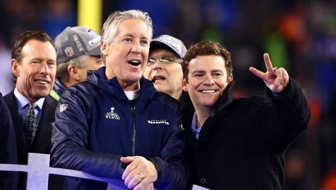 Coach Pete Carroll, middle, celebrates with general manager John Schneider, right, after the Seattle Seahawks won Super Bowl XLVIII on Feb 2, 2014, at MetLife Stadium in East Rutherford, N.J.
