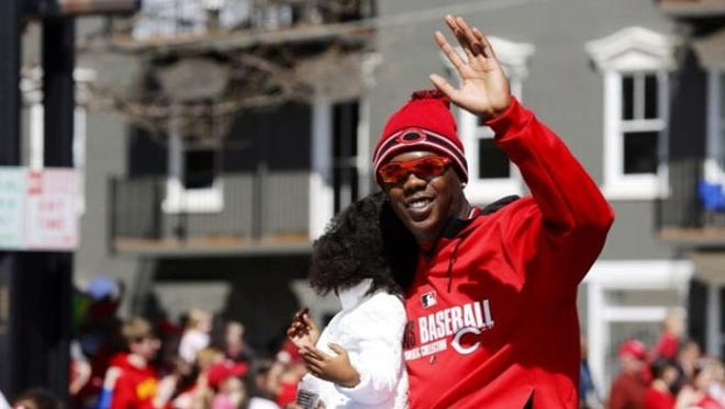 Reds closer Aroldis Chapman waves during the Findlay Market Opening Day Parade.