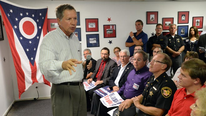 Gov. John Kasich talks to a crowd of about 40 people Tuesday at the Fairfield County Republican Party Headquarters in downtown Lancaster.