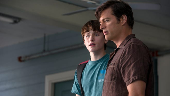 """Harry Connick Jr., right, as Dr. Clay Haskett, and Nathan Gamble as Sawyer Nelson, in a scene from the film, """"Dolphin Tale 2."""""""