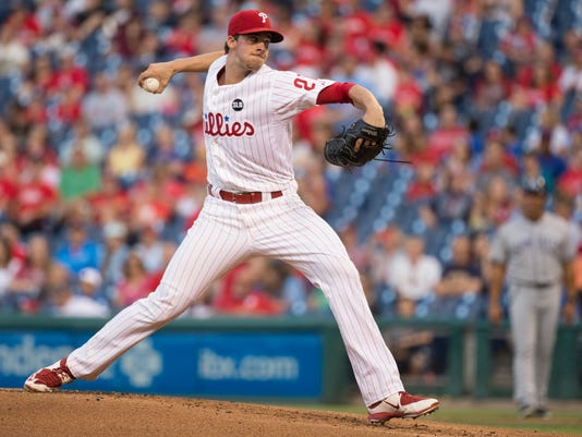 Philadelphia Phillies starting pitcher Aaron Nola throws a pitch during the first inning of a baseball game against the San Diego Padres, Friday, Aug. 28, 2015, in Philadelphia. (AP Photo/Chris Szagola)