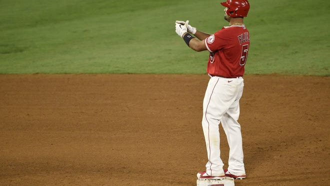 Los Angeles Angels' Albert Pujols celebrates while on second base after a two-run double during the fifth inning of Monday's game against the San Francisco Giants in Anaheim, Calif.