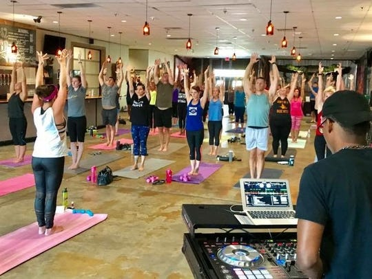 Crystal Lohman teaches power yoga and glow yoga classes