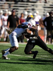 Hardin-Simmons defensive end Donavon Hailey (45) tackles McMurry running back Amonte Bowen (25) for a loss during the second quarter of the Cowboys' 47-17 win on Saturday, Nov. 12, 2016, at HSU's Shelton Stadium. Hemphill scored a school-record six touchdowns in the game.