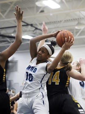 Mount Notre Dame's Naomi Davenport grabs a rebound in a game earlier this season.