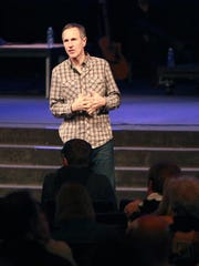 Pastor John Lindell leads a prayer service at James River Assembly in Ozark, MIssouri, in this file photo from 2013.