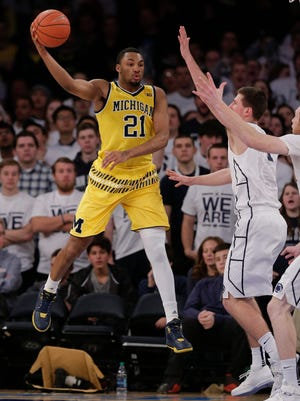 Zak Irvin looks for an open teammate during the first half.