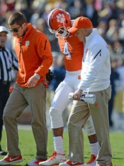 Clemson quarterback Deshaun Watson (4) is helped off the field after injuring his left leg during the 1st quarter against Georgia Tech at Tech's Bobby Dodd Stadium Saturday, November 15, 2014 in Atlanta, Ga.
