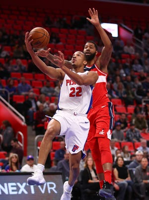 Pistons guard Avery Bradley drives to the basket past Wizards forward Markieff Morris during the first half on Friday, Jan. 19, 2018, at Little Caesars Arena.