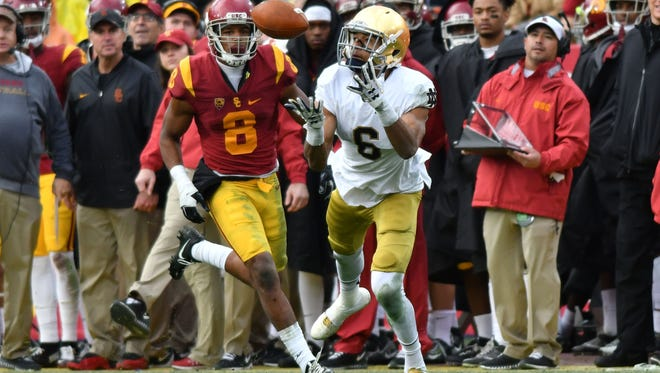 FILE -- Notre Dame Fighting Irish wide receiver Equanimeous St. Brown (6) catches a pass in front of USC Trojans cornerback Ajene Harris (6) in the third quarter at the Los Angeles Memorial Coliseum. USC won 45-27.