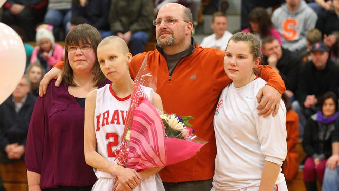 Courtney Wagner takes part in her Senior Night celebration on Feb. 17 with her sister Allie and parents Jamie Wagner and Barry Clark. Courtney is battling cancer but got to score a basket in Canandaigua?s game against Brighton. Courtney Wagner takes part in her senior night celebration with her sister Allie and parents Jamie Wagner and Barry Clark.