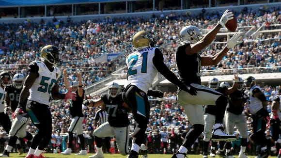Michael Crabtree of the Oakland Raiders scores a touchdown