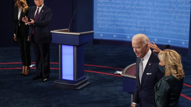 First lady Melania Trump stands with President Donald Trump as he looks at Democratic presidential candidate former Vice President Joe Biden and his wife, Jill Biden, during the first presidential debate Tuesday.