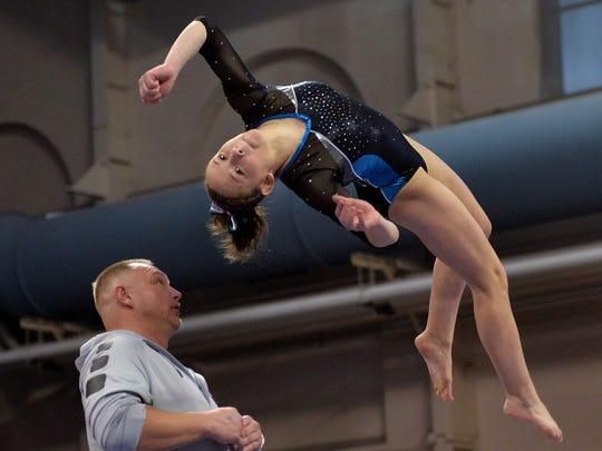 Becker freshman Kaitlin Wilke prepares to dismount