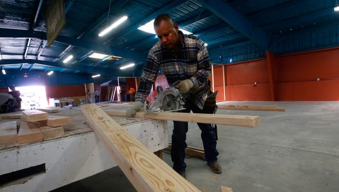 Groundskeeper Ty Sandoval works on Monday inside the exhibit hall at the Northern Navajo Nation Fairgrounds in Shiprock before the start of the Northern Navajo Fair.