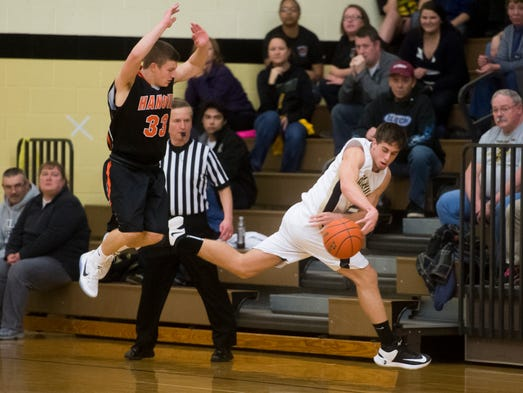 Biglerville's Connor Griest saves the ball from going