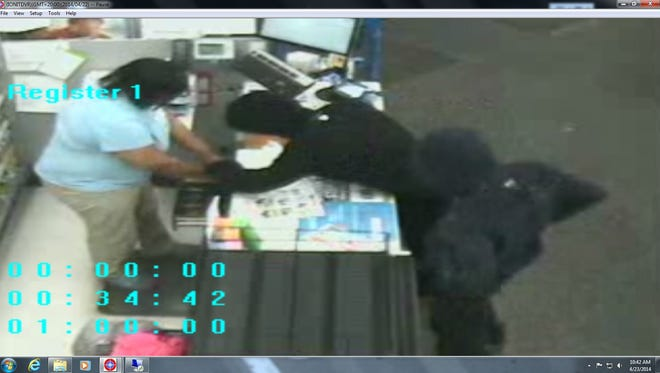 Police are searching for two suspects in connection to the robbery at Walgreens in North College Hill on Tuesday.