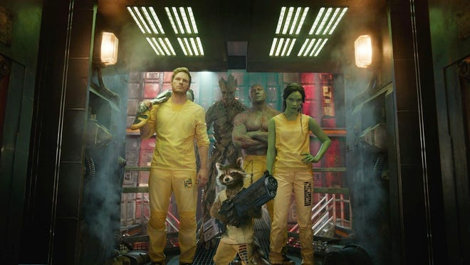 "Chris Pratt, Vin Diesel (voice), Dave Bautista, Zoe Saldana, and Bradley Cooper (voice) star as the ""Guardians of the Galaxy."""