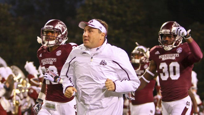 Mississippi State coach Dan Mullen spoke after the team's first practice of the 2014 season on Thursday.