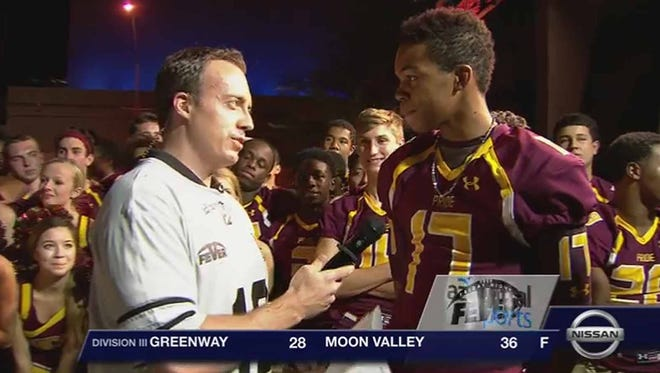 Jake Knapp interviews players from Mountain Pointe High School during Friday Night Fever on Aug. 29, 2014, in Phoenix