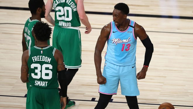 Heat forward Bam Adebayo (13) reacts after scoring and getting fouled against the Boston Celtics in the second half of Tuesday's game at the ESPN Wide World of Sports Complex. Adebayo had 21 points and 12 rebounds in Miami's 111-106 win.