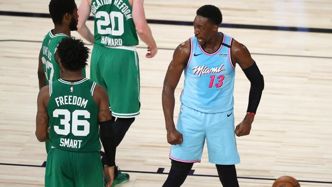 Miami Heat forward Bam Adebayo (13) reacts after scoring and getting fouled against the Boston Celtics during the second half of an NBA basketball game Tuesday, Aug. 4, 2020, in Lake Buena Vista, Fla.