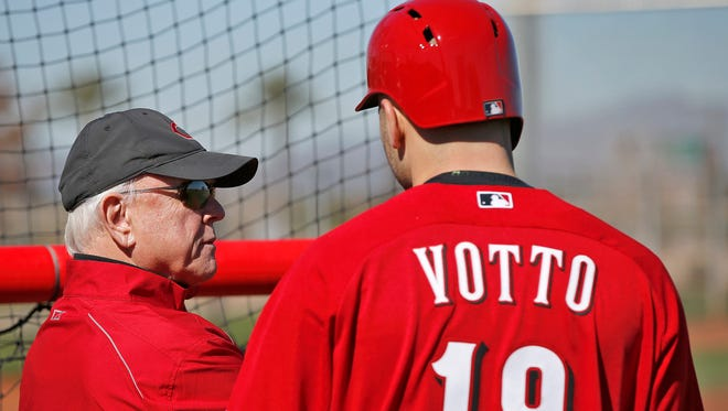 Reds general manager Walt Jocketty, left, talks to first baseman Joey Votto during live batting practice at spring training on Wednesday in Goodyear, Ariz.