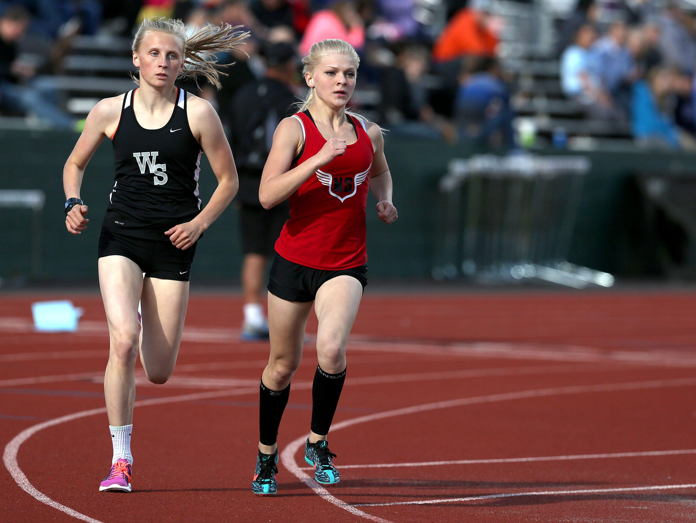 West Salem High school's Brooke Chuhlantseff, left, and North Salem's Madison Willhoft compete in the 1,500 meter race during a Greater Valley Conference meet on Wednesday, May 6, 2015, in Salem, Ore.