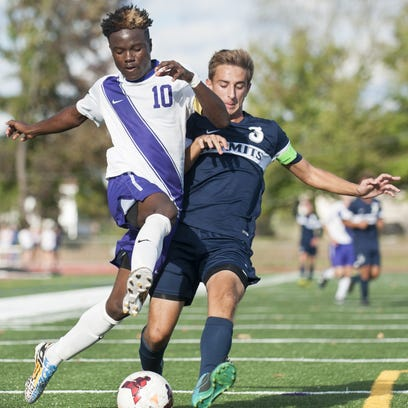 Cherry Hill West's Ishmail Boakai, left, battles St. Augustine's Spencer Infranco for control of the ball during the first half of Monday's SJSCA tourney game.