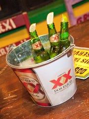 A bucket of Dos Equis beer .
