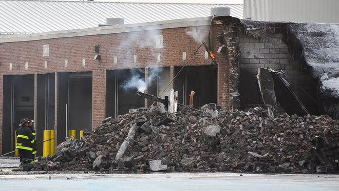 Firefighters were still working on putting out the fire at the Shoemaker Terminal on St. Jean Street in Detroit late Friday morning.