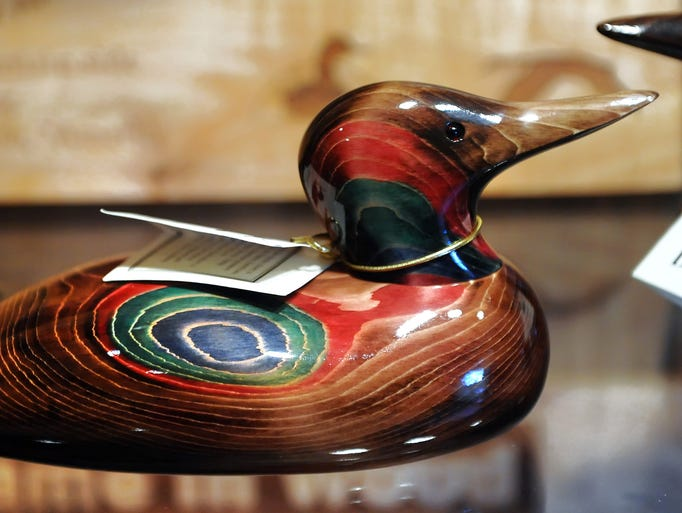John Bundy uses many different kinds of wood and techniques to make his duck decoys as this colored stained technique is his most popular on November 12, 2013. Bundy, owner of Bundy & Company Duck Decoy Carvers, has been running his shop and making decoys for the past 35 years out of his shop located in Noblesville, Indiana.