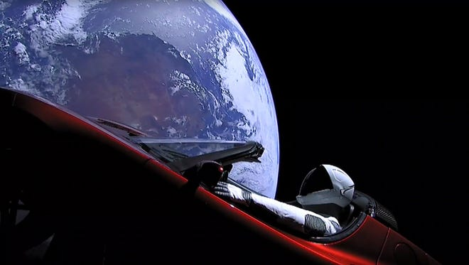 "This still image taken from a SpaceX livestream video shows ""Starman"" sitting in SpaceX CEO Elon Musk's cherry red Tesla roadster after the Falcon Heavy rocket delivered it into orbit around the Earth on February 6, 2018."