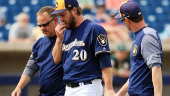 Brewers pitcher Wade Miley leaves the game with a groin injury Wednesday.