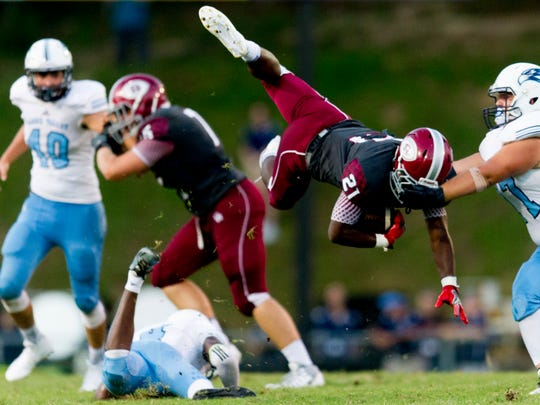 Oak Ridge's Tyrell Romano (21) dives through the air during the second quarter during a game between Hardin Valley and Oak Ridge at Blankenship Field in Oak Ridge, Tennessee on Friday, August 18, 2017.