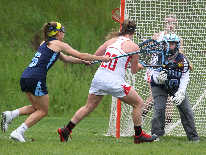 North Rockland's Kaitlyn Gutenberger scores past Suffern goalie Shauna Meehan during their game at North Rockland May 4, 2016. North Rockland won 8-7.