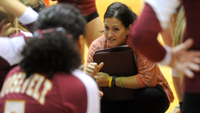 Roosevelt's head coach Holly Lynch talks with her team during a timeout against Lincoln at Lincoln High School in Sioux Falls, S.D., Tuesday, Sept. 10, 2013. (Emily Spartz / Argus Leader)