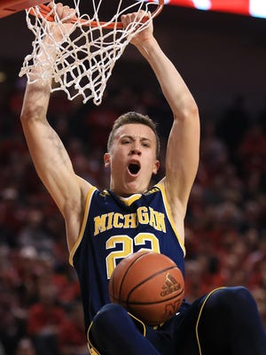 Michigan's Duncan Robinson averaged 11.2 points a game last season. He says an off-season objective of his is to develop physically and improve his skill set.